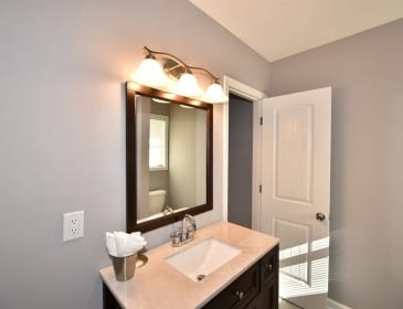 Vanity above sink in remodeled bathroom