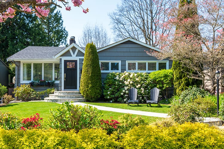 bigstock-Cozy-house-with-beautiful-land-90420128