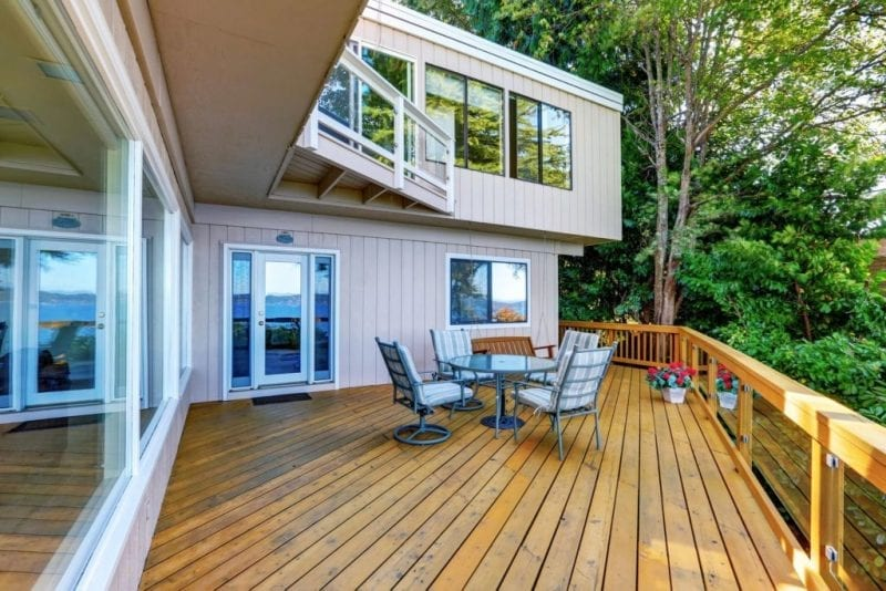 Beautifully remodeled deck with chairs and table