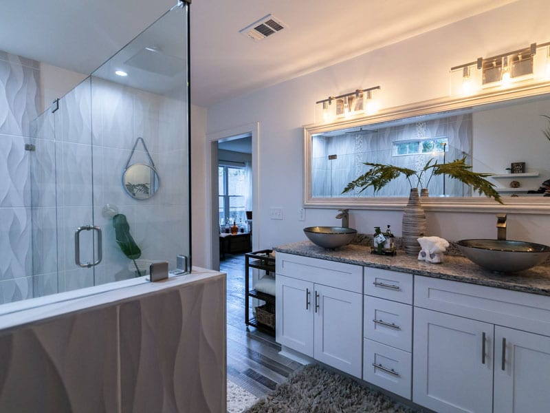 View of European cabinets and porcelain tile flooring in master bathroom remodel